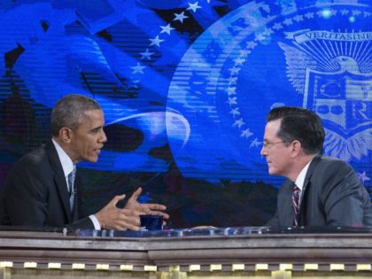 US President Barack Obama speaks with Stephen Colbert during a break in the taping of an interview for Comedy Central's The Colbert Report at George Washington University in Washington on December 8, 2014. AFP PHOTO/Nicholas KAMM (Photo credit should read NICHOLAS KAMM/AFP via Getty Images)