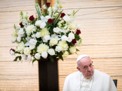 "Pope Francis listens to the speech of Japan's Prime Minister Shinzo Abe as they attend a meeting with the diplomatic community at the prime minister's office in Tokyo on November 25, 2019. - Pope Francis called on November 25 for renewed efforts to help victims of Japan's 2011 ""triple disaster"" …"