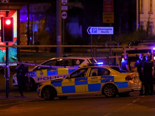 "Police deploy at scene of explosion in Manchester, England, on May 23, 2017 at a concert. British police said early May 23 there were ""a number of confirmed fatalities"" after reports of at least one explosion during a pop concert by US singer Ariana Grande. Ambulances were seen rushing to …"