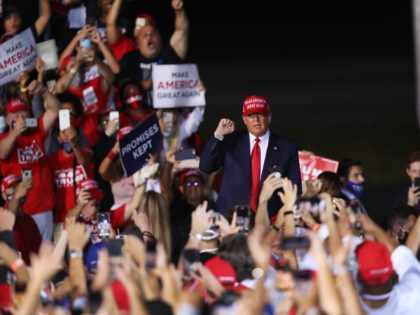 OPA LOCKA, FLORIDA - NOVEMBER 01: U.S. President Donald Trump arrives to speak during his campaign event at Miami-Opa Locka Executive Airport on November 1, 2020 in Opa Locka, Florida. President Trump continues to campaign against Democratic presidential nominee Joe Biden leading up to the November 3rd Election Day. (Photo …