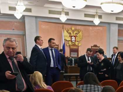 Participants attend a hearing on the justice ministry request to ban the Jehovah's Witnesses at Russia's Supreme Court in Moscow on April 20, 2017. Russia's Supreme Court on April 20 issued a ruling banning Jehovah's Witnesses after finding the group to be extremist. / AFP PHOTO / Vasily MAXIMOV (Photo …