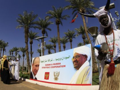 A portrait showing Sudan's President Omar al-Bashir (R) and his Russian counterpart Valdimir Putin is pictured during a welcoming ceremony for Russian Foreign Minister Sergei Lavrov in Khartoum on December 3, 2014. Lavrov held talks with his Sudanese counterpart Ali Karti before attending the Russian-Arab forum on a one-day visit …