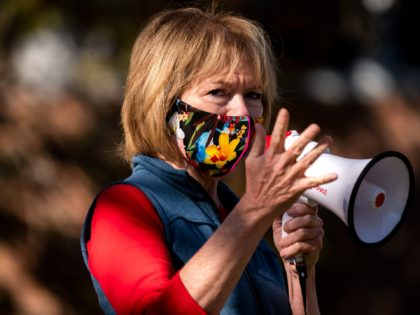 MINNEAPOLIS, MN - NOVEMBER 03: Democratic U.S. Senate candidate Tina Smith (D-MN) speaks during a get out the vote event on the University of Minnesota Campus on November 3, 2020 in Minneapolis, Minnesota. After a record-breaking early voting turnout, Americans head to the polls on the last day to cast …