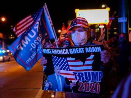 TOPSHOT - Supporters of US President Donald Trump rally in front of cuban restaurant Versailles in Miami, Florida on November 3, 2020. (Photo by Eva Marie UZCATEGUI / AFP) (Photo by EVA MARIE UZCATEGUI/AFP via Getty Images)