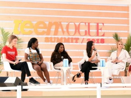 """LOS ANGELES, CA - DECEMBER 01: (L-R) Lily Madigan, Maame Biney, Tia Adeola, Deja Foxx, Cara Delevingne, and Samhita Mukhopadhyay Speaks onstage during the Keynote: CARA DELEVINGNE TEEN VOGUE'S """"21 UNDER 21"""" during The Teen Vogue Summit 2018 at 72andSunny on December 1, 2018 in Los Angeles, California. (Photo by …"""