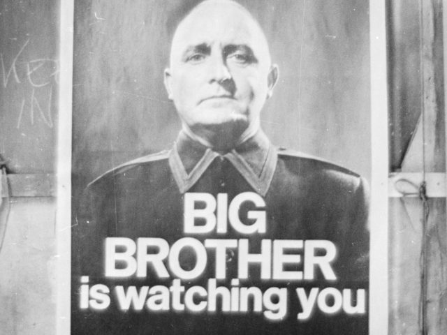 29th June 1965: A poster with the famous words 'Big Brother is Watching You' from a BBC TV production of George Orwell's classic novel '1984'. (Photo by Larry Ellis/Express/Getty Images)