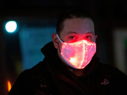 A man wears a face mask on Halloween night in Greenwich Villag, Manhattan, New York City on October 31, 2020. (Photo by Kena Betancur / AFP) (Photo by KENA BETANCUR/AFP via Getty Images)