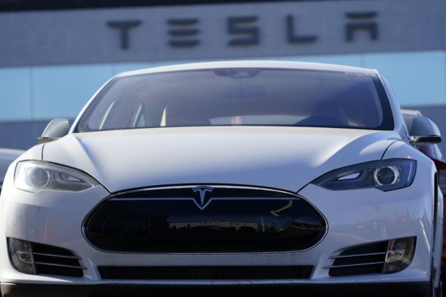 An unsold 2021 S70 sedan sits at a Tesla dealership Sunday, Nov. 8, 2020, in Littleton, Colo. Tesla will be added to the S&P 500 index on Dec. 21. Based on its market value Monday, Nov. 16, 2020, the electric car maker would be one of the top 10 companies …