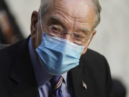 In this Oct. 12, 2020 file photo, Sen. Charles Grassley, R-Iowa, listens during a confirmation hearing for Supreme Court nominee Amy Coney Barrett before the Senate Judiciary Committee, on Capitol Hill in Washington. Grassley, the longest-serving Republican senator, says he is quarantining after being exposed to the coronavirus. Grassley is …