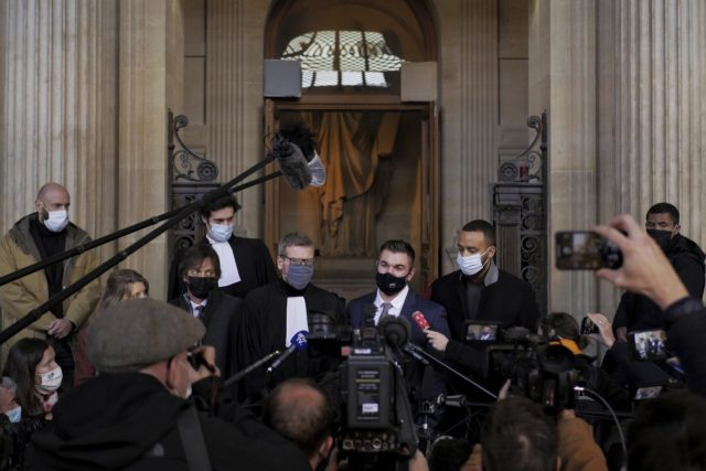 Alek Skarlatos, center right, Anthony Sadler, right, Mark Moogalian, left, and their lawyer Thibault de Montbrial, center left, deliver a speech during the Thalys attack trial at the Paris courthouse, Friday, Nov. 20, 2020. Passengers who wrestled and disarmed an Islamic State gunman aboard a high-speed Amsterdam to Paris train …