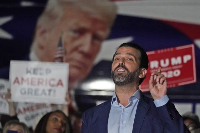 In this Nov. 5, 2020, file photo Donald Trump Jr., gestures during a news conference at Georgia Republican Party headquarters in Atlanta. A spokesman says President Donald Trump's eldest son, Donald Trump Jr., has been infected with the coronavirus. The spokesman says the younger Trump learned his diagnosis earlier this …