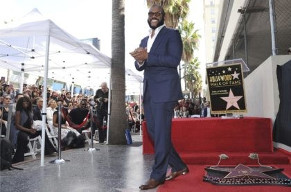 """Filmmaker/actor Tyler Perry, known for the """"Madea"""" films, appears during a ceremony honoring him with with a star on the Hollywood Walk of Fame on Oct. 1, 2019, in Los Angeles. Perry turns 51 on Sept. 14. (Photo by Richard Shotwell/Invision/AP, File)"""
