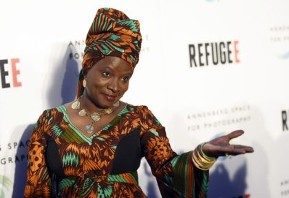 """In this Thursday, April 21, 2016, file photo, singer and UNICEF Goodwill Ambassador Angelique Kidjo poses at the opening of the new photography exhibit """"REFUGEE"""" at The Annenberg Space for Photography in Los Angeles. Kidjo uses her artistry and her activism to connect beyond language and skin color. Kidjo and …"""