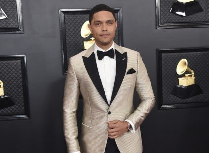Trevor Noah arrives at the 62nd annual Grammy Awards in Los Angeles on Jan. 26, 2020. Noah has been tapped to host the 2021 Grammy Awards. The Recording Academy made the announcement hours before the nominees for the 2021 show would be revealed. It would mark Noah's first time hosting …