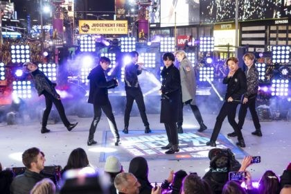 "Members of BTS perform at the Times Square New Year's Eve celebration in New York on Dec. 31, 2019. The K-pop band is nominated for a Grammy Award for best pop duo/group performance with ""Dynamite,"" their first song to hit the No. 1 spot on the Billboard Hot 100 chart. …"