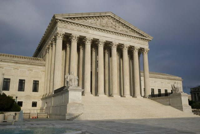 In this May 3, 2020, file photo, the setting sun shines on the Supreme Court building in Washington. As coronavirus cases surge again nationwide, the Supreme Court late Wednesday, Nov. 25, temporarily barred New York from enforcing certain attendance limits at houses of worship in areas designated as hard hit …