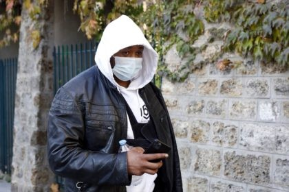 Music producer identified only by his first name, Michel, is pictured on his way to the Inspectorate General of the National Police, known by its French acronym IGPN, in Paris, Thursday, Nov. 26, 2020. French Interior Minister Gerald Darmanin ordered several Paris police officers suspended after the publication of videos …