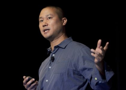 In this Sept. 30, 2013, file photo, Tony Hsieh speaks during a Grand Rapids Economic Club luncheon in Grand Rapids, Mich. Hsieh, retired CEO of Las Vegas-based online shoe retailer Zappos.com, has died. Hsieh was with family when he died Friday, Nov. 27, 2020, according to a statement from DTP …