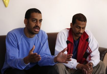 "In this March 30, 2019, file photo, Alexanda Amon Kotey, left, and El Shafee Elsheikh, who were allegedly among four British jihadis who made up a brutal Islamic State cell dubbed ""The Beatles,"" speak during an interview with The Associated Press at a security center in Kobani, Syria. (AP Photo/Hussein …"