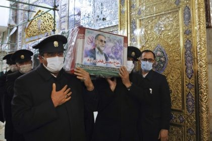 In this picture released by the Iranian Defense Ministry and taken on Saturday, Nov. 28, 2020, caretakers from the Imam Reza holy shrine, carry the flag draped coffin of Mohsen Fakhrizadeh, an Iranian scientist linked to the country's disbanded military nuclear program, who was killed on Friday, during a funeral …