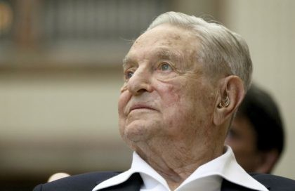 In this June 21, 2019 file photo, George Soros, founder and chairman of the Open Society Foundations, looks before the Joseph A. Schumpeter award ceremony in Vienna, Austria. (AP Photo/Ronald Zak, File)