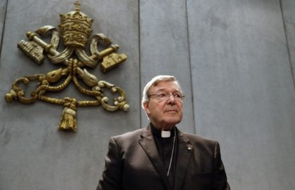 In this June 29, 2017, file photo, Cardinal George Pell prepares to make a statement, at the Vatican. Cardinal George Pell, who was convicted and then acquitted of sexual abuse in his native Australia, reflects on the nature of suffering, Pope Francis' papacy and the humiliations of solitary confinement in …