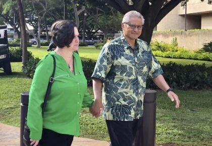In this March 12, 2019, file photo, retired Honolulu police chief Louis Kealoha and his wife, former deputy city prosecutor Katherine Kealoha, hold hands while walking to U.S. district court in Honolulu. A once-respected, now-estranged power couple are scheduled to be sentenced Monday, Nov. 30, 2020, in Hawaii's biggest corruption …