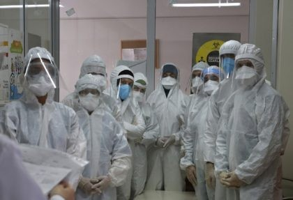 In this Friday, May 15, 2020, file photo, a team of Turkey's Health Ministry's coronavirus contact tracing team, clad in white protective gear, masks and face shields are briefed in Istanbul. When Turkey changed the way it reports daily COVID-19 infections, it confirmed what medical groups and opposition parties have …