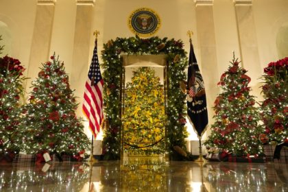 Cross Hall and the Blue Room are decorated during the 2020 Christmas preview at the White House, Monday, Nov. 30, 2020, in Washington. (AP Photo/Patrick Semansky)