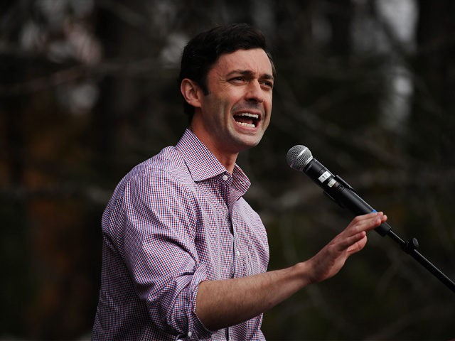 LILBURN, GEORGIA - DECEMBER 07: Jon Ossoff, Democratic candidate for the U.S. Senate, speaks at a campaign event to register Democrats to vote in the January 5th senate runoff election on December 07, 2020 in Lilburn, Georgia. Ossoff is running against Sen. David Perdue (R-GA) while his fellow Democrat, Rev. …