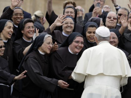 Pope Francis meets a group of Franciscan nuns during his weekly general audience, in St. Peter's Square, at the Vatican, Wednesday, May 9, 2018. (AP Photo/Andrew Medichini)