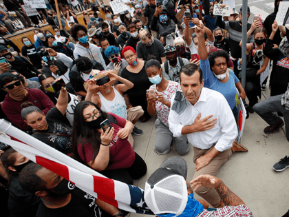 Mayor Sam Liccardo takes a knee with group of protesters in San Jose, Calif., Sunday, May 31, 2020. Protests continue across the United States over the death of George Floyd, a black man who died after being restrained by Minneapolis police officers on May 25. (AP Photo/Josie Lepe)