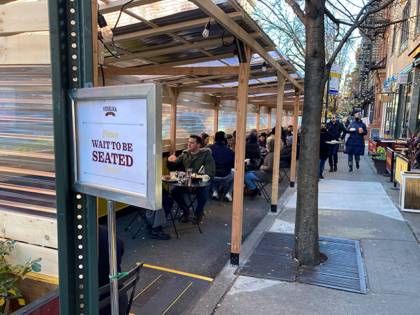 Outdoor dining with social distancing measures in Downtown Manhattan on December 6, 2020. Though certain restrictions were eased as part of the Phase 4 Reopening in New York City during the worldwide coronavirus pandemic, recent surges in cases of the virus have led restaurant owners and managers to create and …