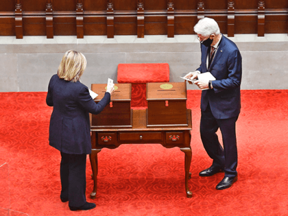 New York Electoral College members, Former Sec. of State Hillary Clinton, left, and Former President Bill Clinton, vote for President and Vice President in the Assembly Chamber at the state Capitol in Albany, N.Y., Monday, Dec. 14, 2020. (AP Photo/Hans Pennink, Pool)