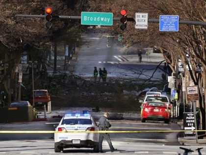 A Nashville Police officer blocks the entrance to the scene of an explosion Saturday, Dec. 26, 2020, in Nashville, Tenn. The explosion that shook the largely deserted streets of downtown Nashville early Christmas morning shattered windows, damaged buildings and wounded three people. Authorities said they believed the blast was intentional. …