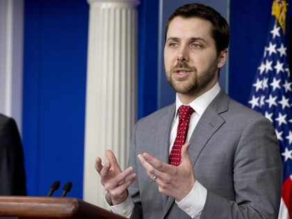 Brian Deese, senior adviser, right, speaks to the media, accompanied by White House Press Secretary Josh Earnest, speaks during the daily news briefing at the White House in Washington, Thursday, March 19, 2015. (AP Photo/Jacquelyn Martin)