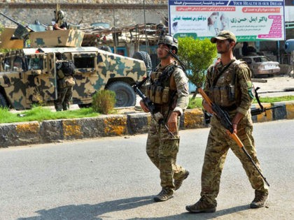 Afghan soldiers patrol outside a prison during an ongoing raid in Jalalabad on August 3, 2020. - Afghan authorities on August 3 deployed more security forces and tanks to end a raid on a prison claimed by the Islamic State group that has so far left 13 civilians dead. (Photo …