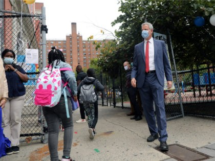 New York City Mayor Bill de Blasio stands at P.S. 188 as he welcomes elementary school students back to the city's public schools for in-person learning on September 29, 2020 in New York City. Middle and high schoolers will start on Oct. 1 while Pre-K students and students with disabilities …