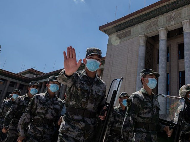 Chinese soldiers walk outside the Great Hall of the People at the end of a ceremony to honour people who fought against the COVID-19 pandemic, in Beijing on September 8, 2020. (Photo by NICOLAS ASFOURI / AFP) (Photo by NICOLAS ASFOURI/AFP via Getty Images)