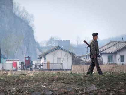 A North Korean soldier walks near the Yalu river near Sinuiju, opposite the Chinese border city of Dandong, on April 16, 2017. Dandong city is the main crossing point to North Korea, and every day hundreds of tourists embark on small boats for a cruise on the Yalu border river …