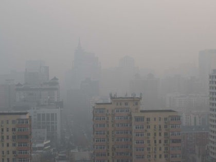 Buildings are seen on a polluted day in Beijing on January 18, 2020. (Photo by NICOLAS ASFOURI / AFP) (Photo by NICOLAS ASFOURI/AFP via Getty Images)