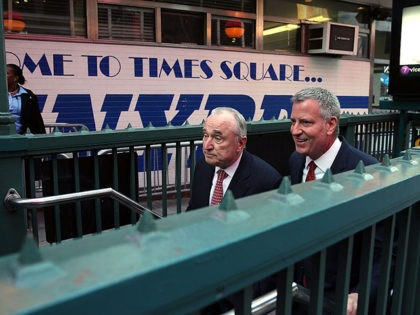 NEW YORK, NY - MARCH 22: New York City Mayor Bill de Blasio (right) is joined by Police Commissioner William Bratton as they emerge from the subway for a news conference in Times Square where the two spoke about a heightened terror alert in New York after attacks in the …