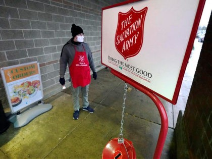 CORRECTS SPELLING OF DATELINE TO LYNDEN INSTEAD OF LINDEN - Salvation Army bell ringer Michael Cronin staffs the charity's red donation kettle in front of a grocery store, Tuesday, Dec. 8, 2020, in Lynden, Wash. Despite record amounts of charitable donations this year, nonprofits across the country are being suffocated …