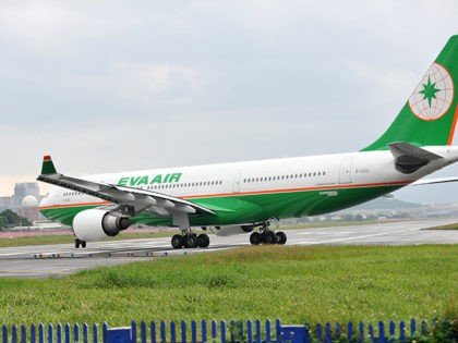 A passenger aircraft of Taiwan's EVA Airways lines up to take off from Sungshan airport in Taipei on October 31, 2010. AFP PHOTO/PATRICK LIN (Photo credit should read PATRICK LIN/AFP via Getty Images)
