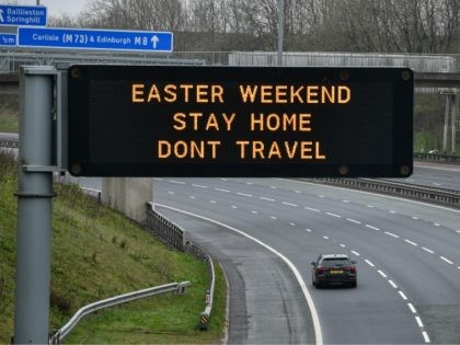 GLASGOW, SCOTLAND - APRIL 09: An overhead sign on the M8 advises people not to travel this Easter Weekend on April 9, 2020 in Glasgow, Scotland. There have been around 60,000 reported cases of the COVID-19 coronavirus in the United Kingdom and 7,000 deaths. The country is in its third …
