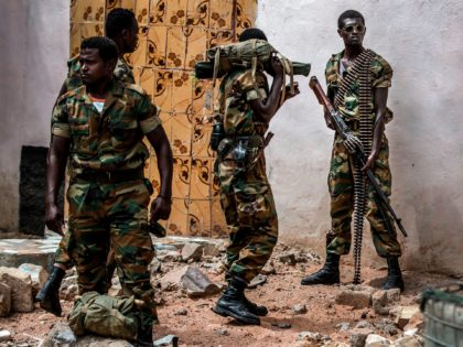 TOPSHOT - A group of heavily armed Ethiopian soldiers deployed in Somalia as part of the African Union peacekeeping mission patrol in Beledweyne, Somalia, on December 14, 2019. (Photo by LUIS TATO / AFP) (Photo by LUIS TATO/AFP via Getty Images)