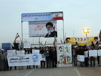 """Iranian students carrying anti-US placards and portraits of the Islamic republic's supreme leader Ayatollah Ali Khamenei protest outside the Fordo Uranium Conversion Facility in Qom, in the north of the country, on November 19, 2013. Iran said there was """"every possibility"""" of a deal at international talks on its nuclear …"""