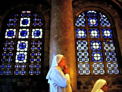 """Catholic nuns pray during a mass in the The Basilica of the Agony or Gethsemane, where Christians believe Jesus Christ suffered The Agony, at the foot of the Mount of Olives in Jerusalem, Saturday, April 2, 2005. Pope John Paul II's condition remains unchanged and """"very grave,"""" and he is …"""