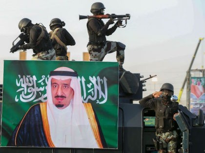 Saudi armed forces take part in a parade in Saudi Arabia's holy city of Mecca during a military drill on August 13, 2018, behind a portrait of the Saudi King Salman, ahead of the annual Hajj pilgrimage, - The hajj to Mecca, the most revered site in Islam, is a …