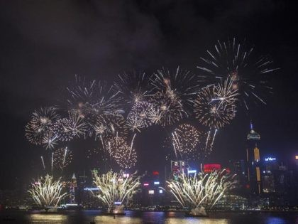Fireworks are seen over Victoria Harbour to celebrate the Lunar New Year in Hong Kong on February 6, 2019, to mark the year of the Pig. (Photo by ISAAC LAWRENCE / AFP) (Photo credit should read ISAAC LAWRENCE/AFP via Getty Images)